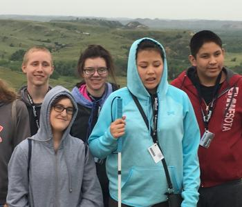 Students who attended Teen Camp 2018 in Medora posing in the Badlands.