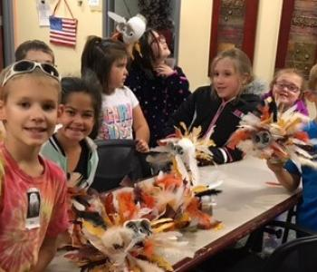 Elementary students after completing an owl art project.